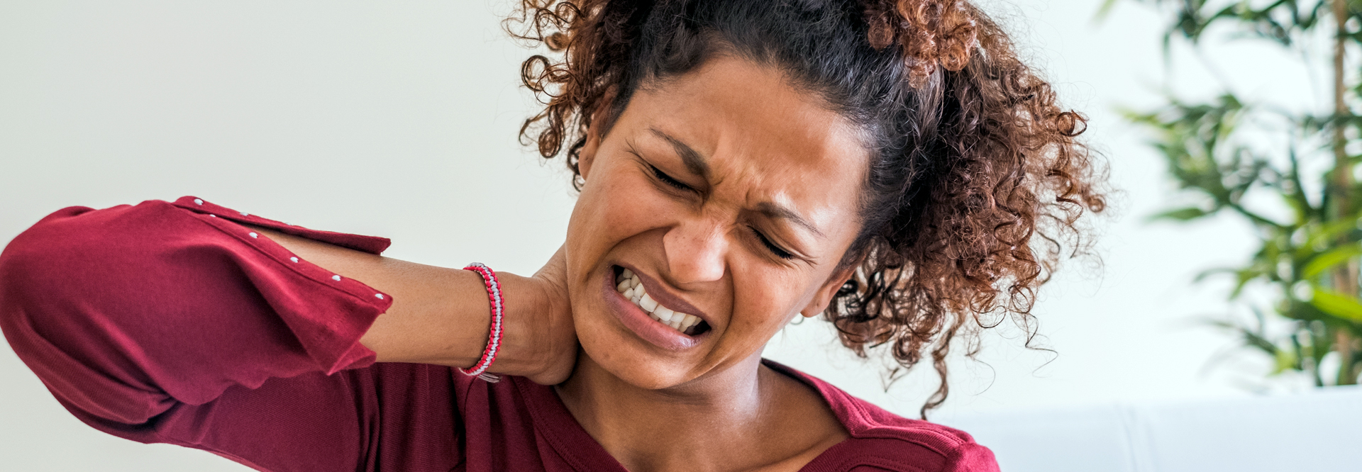 image of women with hurt neck needing relief factors
